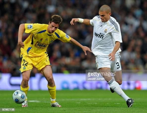 Borja PerezPenas of AD Alcorcon duels for the ball with Pepe of Real Madrid during the Copa del Rey fourth round second leg match between Real Madrid...