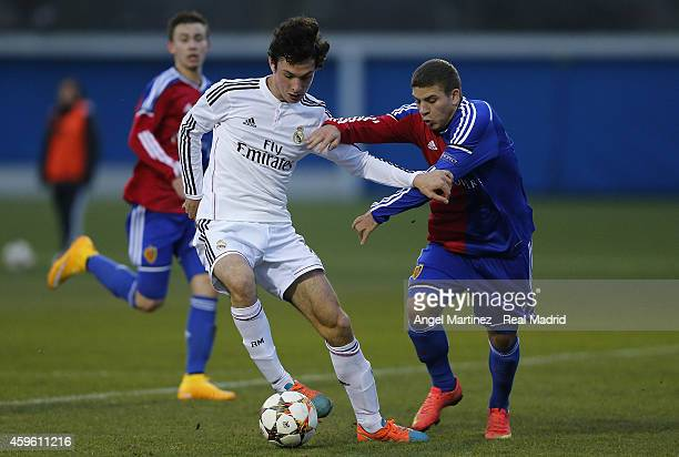 Borja Sanchez of Real Madrid competes for the ball with Antonio Fischer of FC Basel 1893 during the UEFA Youth League match between FC Basel 1893 and...