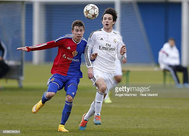 Borja Sanchez of Real Madrid competes for the ball with Robin Huser of FC Basel 1893 during the UEFA Youth League match between FC Basel 1893 and...