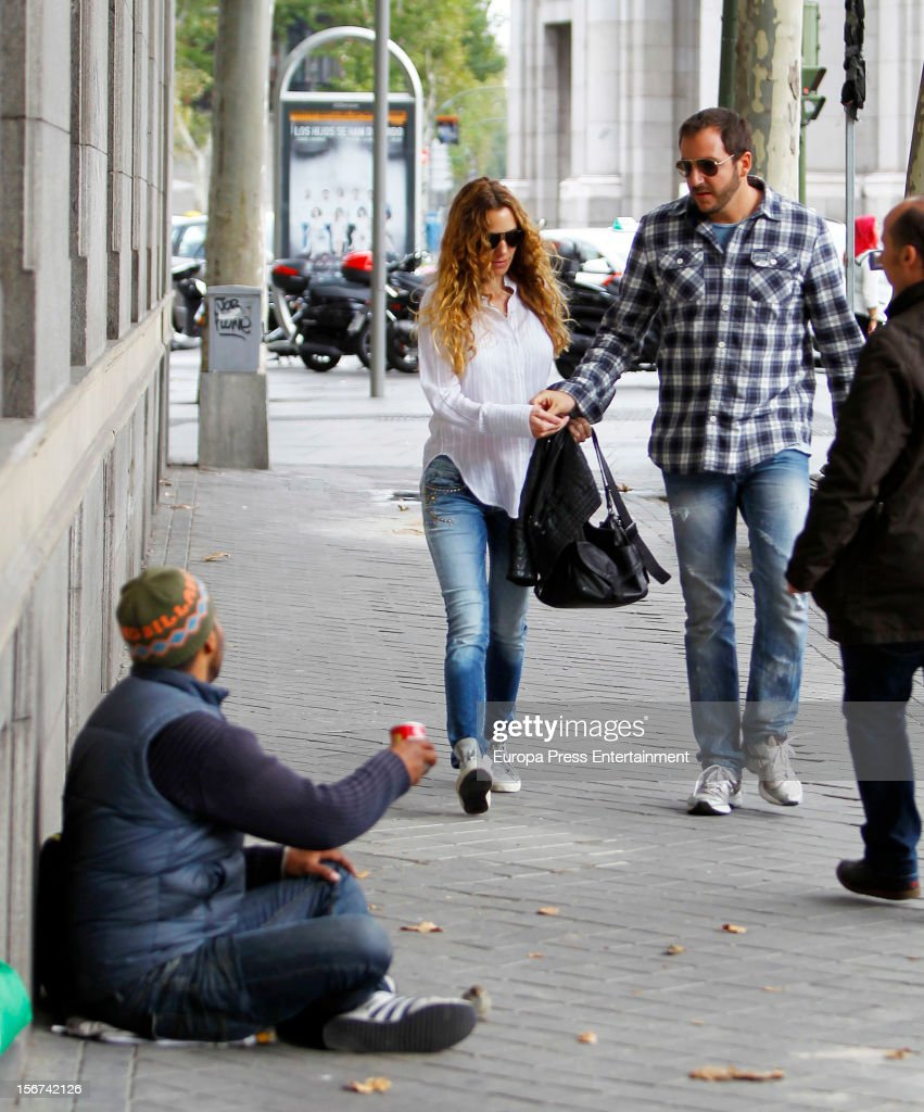 Borja Thyssen-Bornemisza and Blanca Cuesta give alms to a beggar on November 19, 2012 in Madrid, Spain.