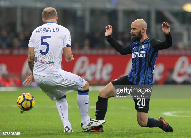 Borja Valero Iglesias of FC Internazionale competes for the ball with Andrea Masiello of Atalanta BC during the Serie A match between FC...