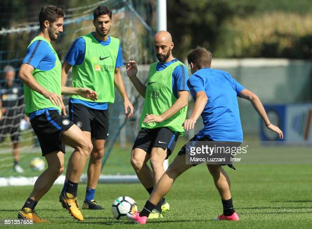 Borja Valero is challenged by Roberto Gagliardini during the FC Internazionale training session at the club's training ground Suning Training Center...
