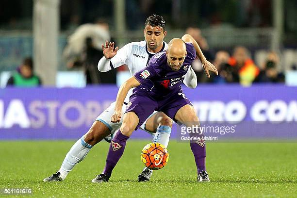 Borja Valero of ACF Fiorentina battles for the ball with Mauricio of SS Lazio during the Serie A match between ACF Fiorentina and SS Lazio at Stadio...