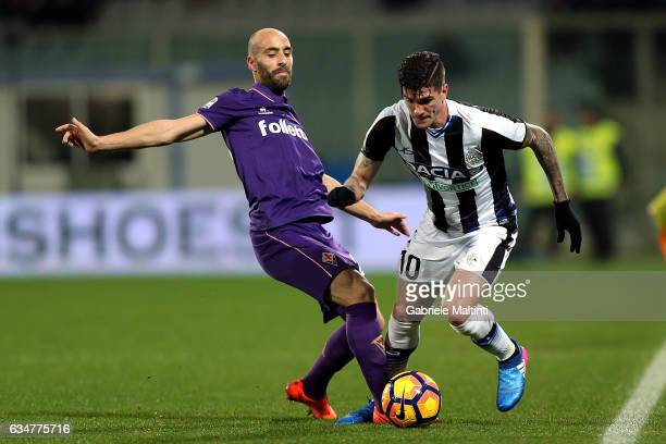 Borja Valero of ACF Fiorentina battles for the ball with Rodrigo De Paul of Udinese Calcio during the Serie A match between ACF Fiorentina and...