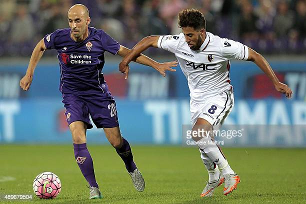 Borja Valero of ACF Fiorentina battles for the ball with Saphir Taider of Bologna FC during the Serie A match between ACF Fiorentina and Bologna FC...