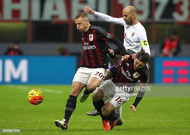 Borja Valero of ACF Fiorentina competes for the ball with Ignazio Abate and Riccardo Montolivo of AC Milan during the Serie A match between AC Milan...
