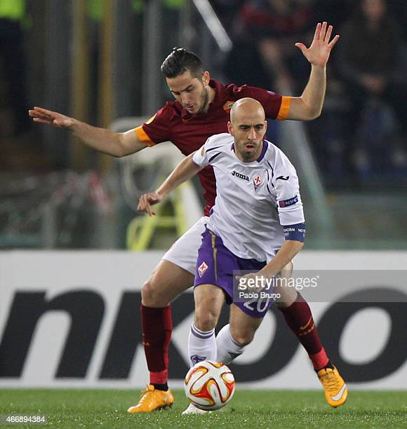Borja Valero of ACF Fiorentina competes for the ball with Kostas Manolas of AS Roma during the UEFA Europa League Round of 16 match between AS Roma...
