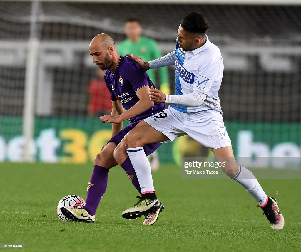 Borja Valero of ACF Fiorentina competes for the ball with Lucas Castro of AC Chievo during the Serie A match between AC Chievo Verona and ACF...