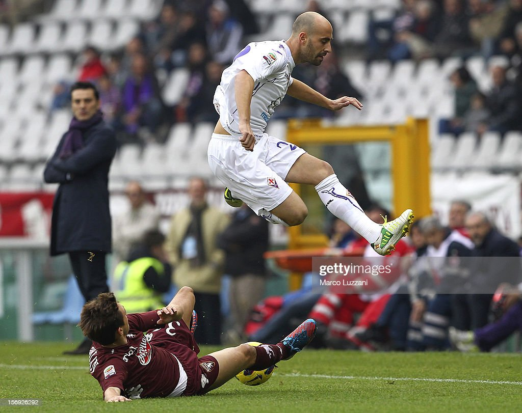 <a gi-track='captionPersonalityLinkClicked' href=/galleries/search?phrase=Borja+Valero&family=editorial&specificpeople=4821853 ng-click='$event.stopPropagation()'>Borja Valero</a> (up)of ACF Fiorentina competes for the ball with Matteo Darmian (down) of Torino FC during the Serie A match between Torino FC and ACF Fiorentina at Stadio Olimpico di Torino on November 25, 2012 in Turin, Italy.