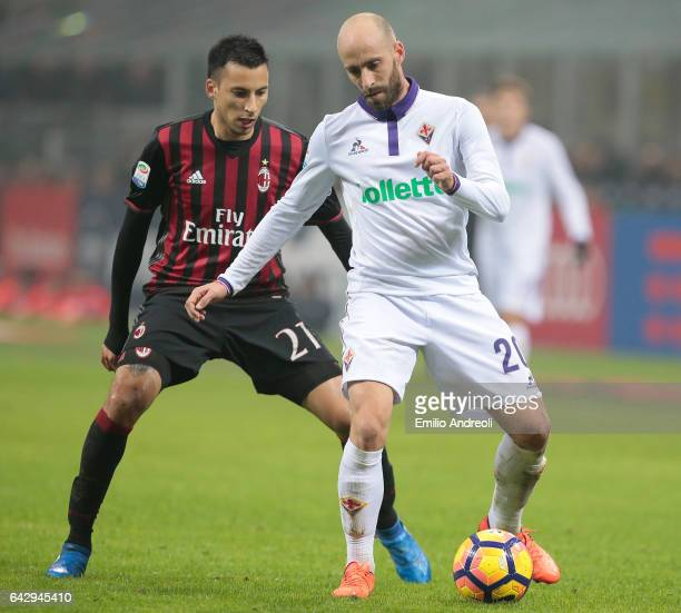 Borja Valero of ACF Fiorentina is challenged by Leonel Vangioni of AC Milan during the Serie A match between AC Milan and ACF Fiorentina at Stadio...