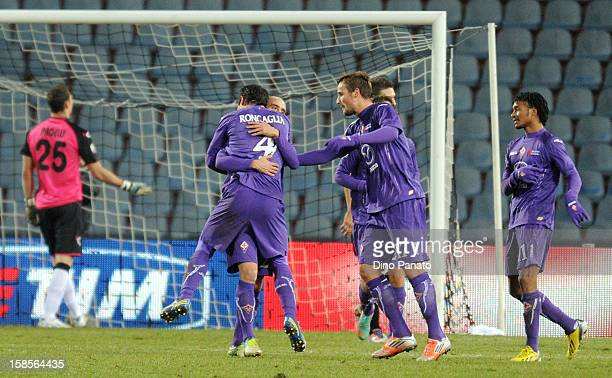 Borja Valero of AFC Fiorentina celebrate after scoring his opening second goal with their team mate during the TIM Cup match between Udinese Calcio...