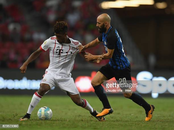 Borja Valero of FC Internazionale of FC Internazionale and Kingsley Coman of Bayern compete for the ball during the International Champions Cup match...