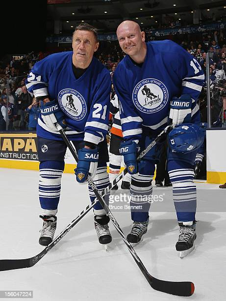 Borje Salming and Mats Sundin pose for photos following the Hall of Fame Legends Game at the Air Canada Centre on November 11 2012 in Toronto Canada...