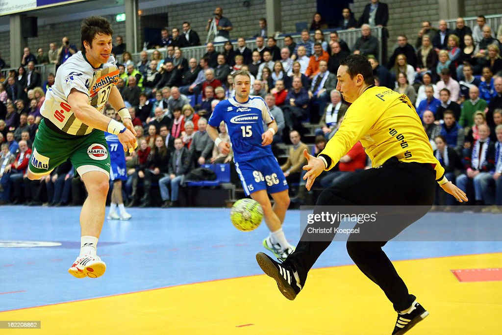 Borko Ristovski of Gummersbach (R) saves a ball against Momir Rnic of Goeppingen (L) during the DKB Handball Bundesliga match between VfL Gummersbach and FrischAuf Goeppingen at Eugen-Haas-Sporthalle on February 20, 2013 in Gummersbach, Germany.