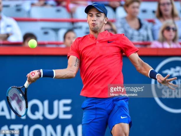 Borna Coric of Croatia hits a return against Rafael Nadal of Spain during day six of the Rogers Cup presented by National Bank at Uniprix Stadium on...
