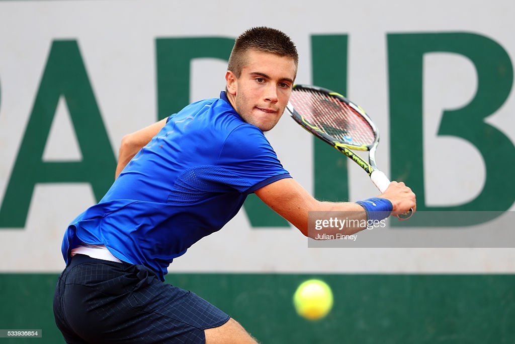 Borna Coric of Croatia plays a backhand during the Men's Singles first round match against Taylor Fritz of United States on day three of the 2016 French Open at Roland Garros on May 24, 2016 in Paris, France.