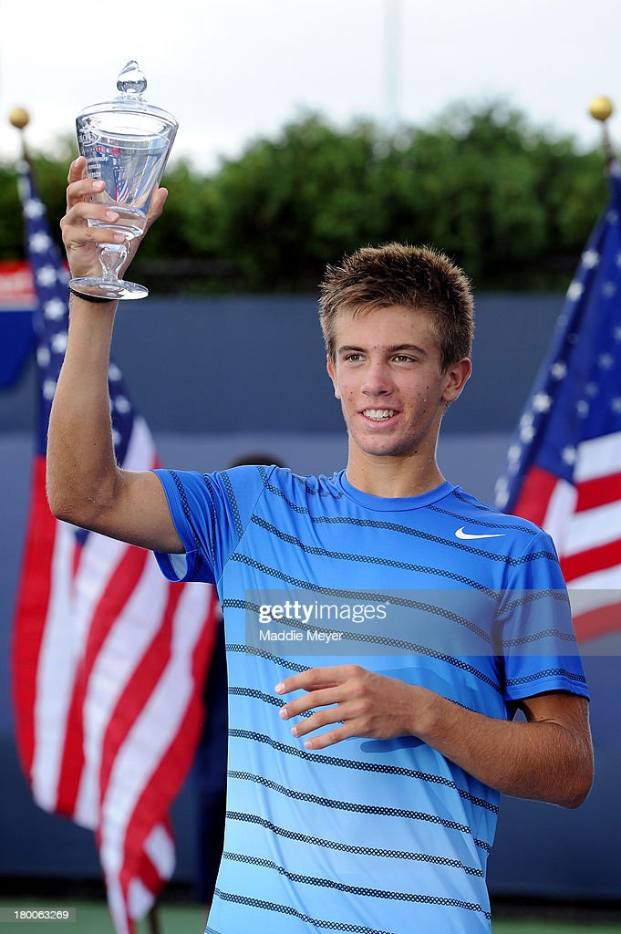 Borna Coric of Croatia poses with the trophy after winning his junior boys' singles final against Thanasi Kokkinakis of Australia on Day Fourteen of the 2013 US Open at the USTA Billie Jean King National Tennis Center on September 8, 2013 in the Flushing neighborhood of the Queens borough of New York City. Coric defeated Kokkinakis 3-6 6-3 6-1.