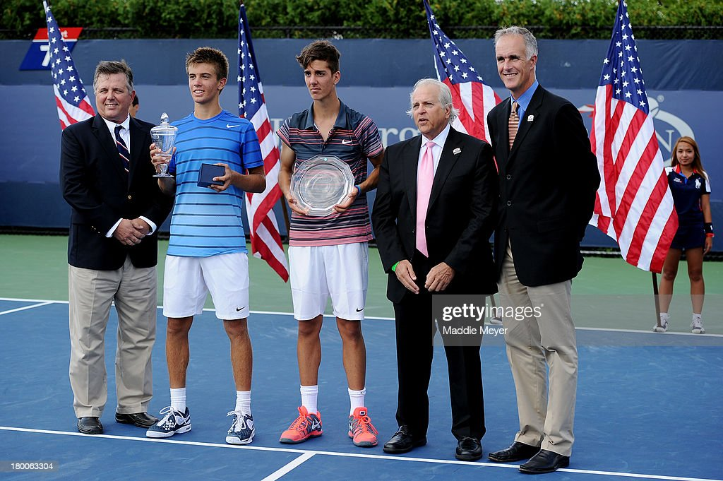 Borna Coric (2nd L) of Croatia poses with the trophy next to Thanasi Kokkinasis (C) of Australia after their junior boys' singles final on Day Fourteen of the 2013 US Open at the USTA Billie Jean King National Tennis Center on September 8, 2013 in the Flushing neighborhood of the Queens borough of New York City. Coric defeated Kokkinakis 3-6 6-3 6-1.