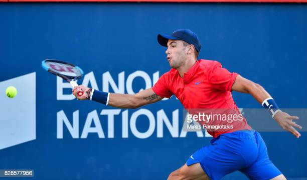 Borna Coric of Croatia reaches for the ball against Rafael Nadal of Spain during day six of the Rogers Cup presented by National Bank at Uniprix...