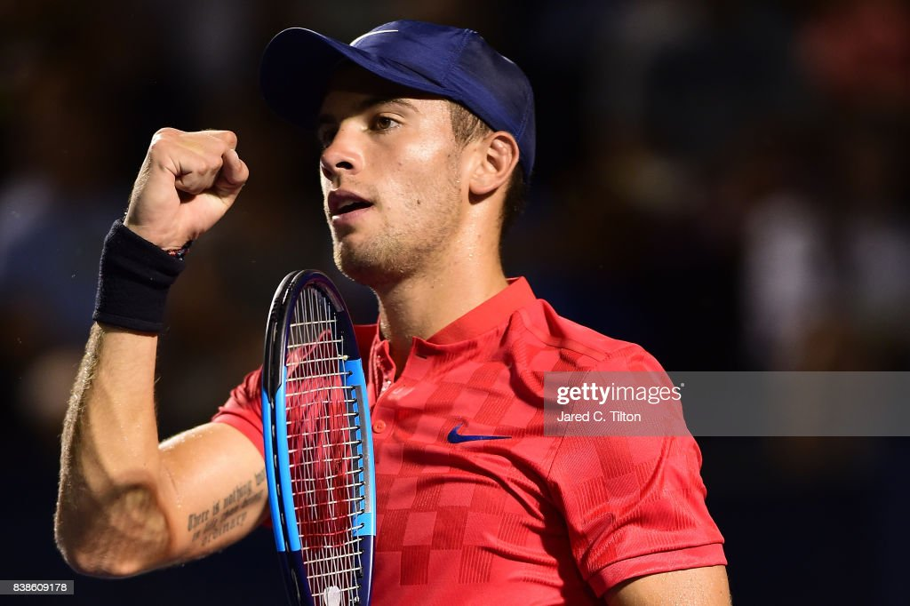 Borna Coric of Croatia reacts after winning his match against John Isner during the fifth day of the Winston-Salem Open at Wake Forest University on August 23, 2017 in Winston-Salem, North Carolina.