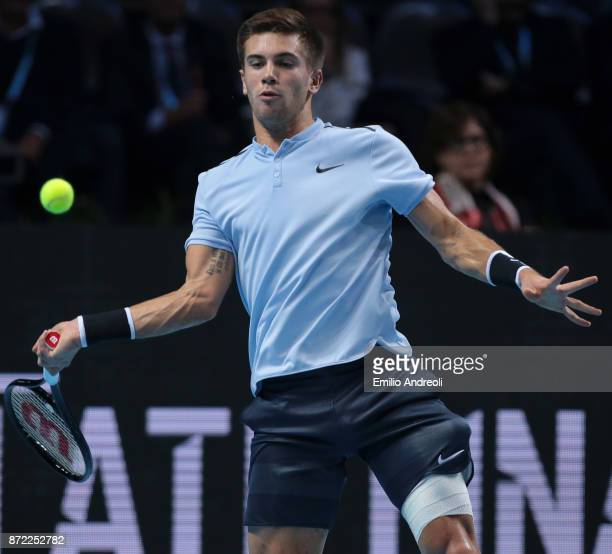 Borna Coric of Croatia returns a forehand in his group stage match against Karen Khachanov of Russia during Day 3 of the Next Gen ATP Finals on...
