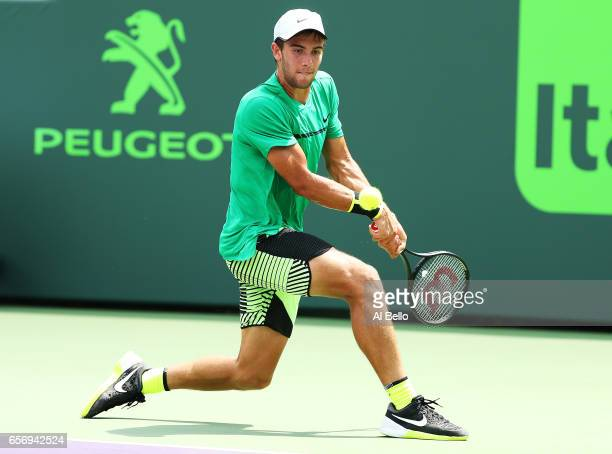 Borna Coric of Croatia returns a shot against Marcel Granollers of Spain during Day 4 of the Miami Open at Crandon Park Tennis Center on March 23...