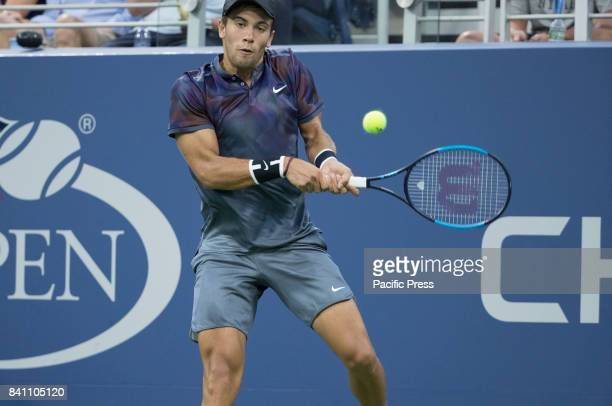 Borna Coric of Croatia returns ball during match against Alexander Zverev of Germany at US Open Championships at Billie Jean King National Tennis...