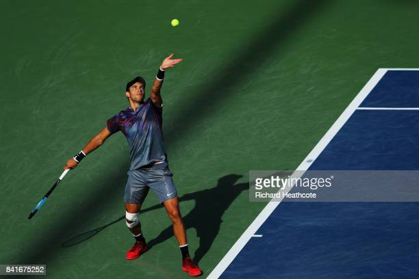 Borna Coric of Croatia returns serves to Kevin Anderson of South Africa during their third round match on Day Five of the 2017 US Open at the USTA...