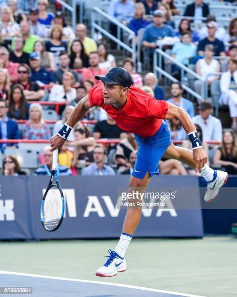 Borna Coric of Croatia serves against Rafael Nadal of Spain during day six of the Rogers Cup presented by National Bank at Uniprix Stadium on August...