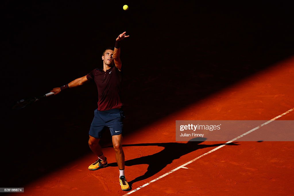 Borna Coric of Croatia serves to Novak Djokovic of Serbia during day five of the Mutua Madrid Open tennis tournament at the Caja Magica on May 04, 2016 in Madrid, Spain.