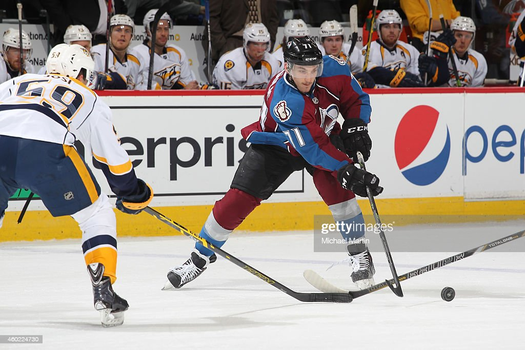 Borna Rendulic #71 of the Colorado Avalanche skates in his first career NHL game against Roman Josi #59 of the Nashville Predators at the Pepsi Center on December 9, 2014 in Denver, Colorado. The Predators defeated the Avalanche 3-0.