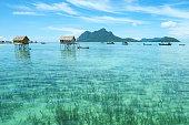 Landscape view borneo sea gypsy water village in Mabul Maiga Island, Malaysia.