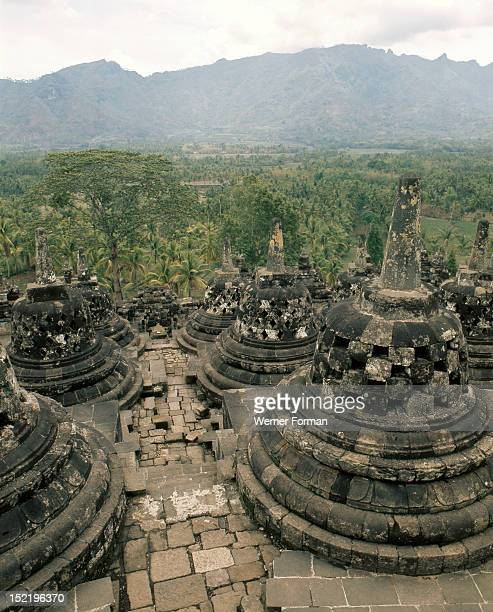 Borobudur A view of the upper circular terraces Each stupa houses a figure of the DhyaniBuddha Vajrasattva in the attitude of preaching Indonesia...
