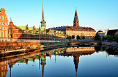 Borsen Building (The Old Stock Exchange) & Christiansborg Palace at sunrise, Copenhagen, Denmark