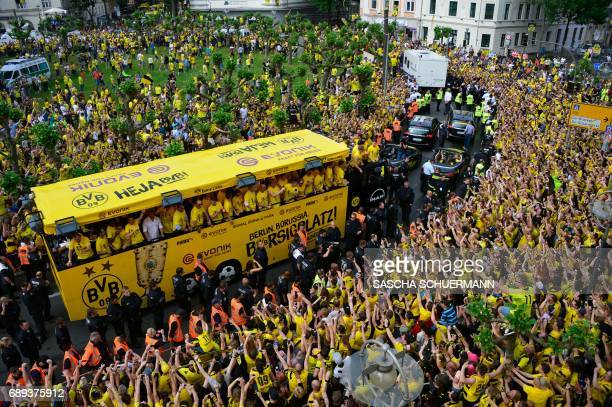 Borussia Dortmund arrive players at Borsigplatz during celebrations after winning the German Cup final in Dortmund western Germany on May 28 2017 /...