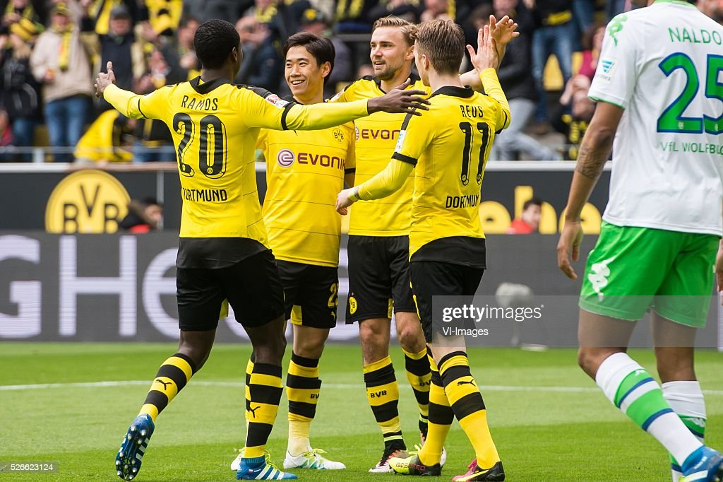 Borussia Dortmund celebrate a goal of Shinji Kagawa of Borussia Dortmund during the Bundesliga match between Borussia Dortmund and VfL Wolfsburg on April 30, 2016 at the Signal Idun Park stadium in Dortmund, Germany.