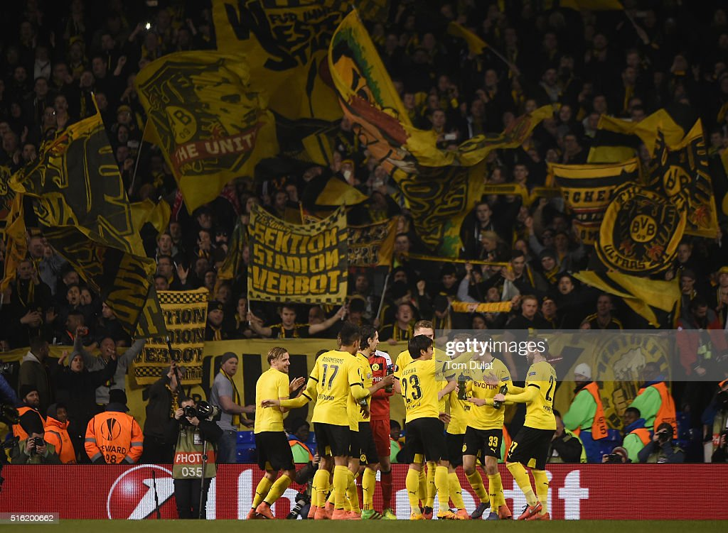Borussia Dortmund celebrate victory with their fans after the UEFA Europa League round of 16, second leg match between Tottenham Hotspur and Borussia Dortmund at White Hart Lane on March 17, 2016 in London, England.