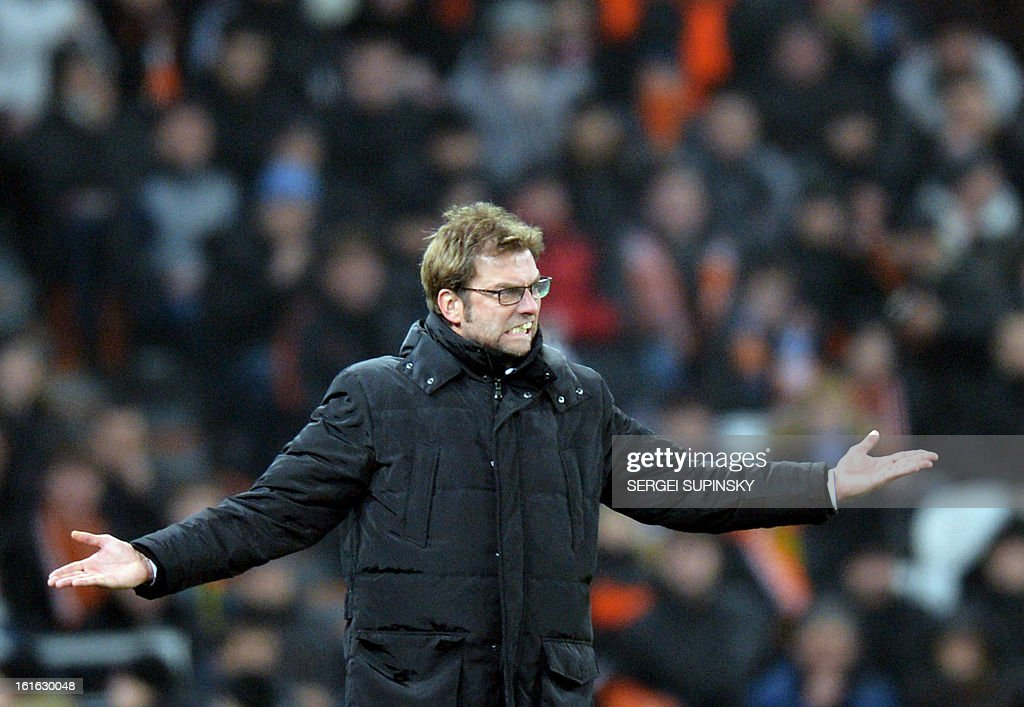 Borussia Dortmund coach Jurgen Klopp reacts during the UEFA Champions League round 16 football match with FC Shakhtar in Donetsk on February 13, 2013.
