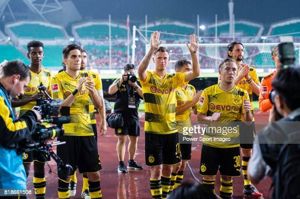 Borussia Dortmund Defender Erik Durm and his teammates interacting with supporters during the International Champions Cup 2017 match between AC Milan...