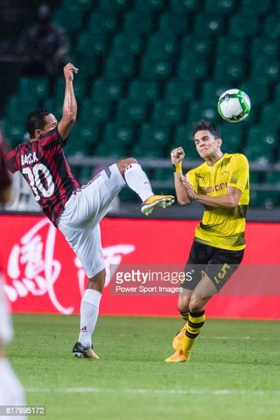 Borussia Dortmund Defender Marc Bartra trips up with AC Milan Midfielder Hakan Calhanoglu during the International Champions Cup 2017 match between...