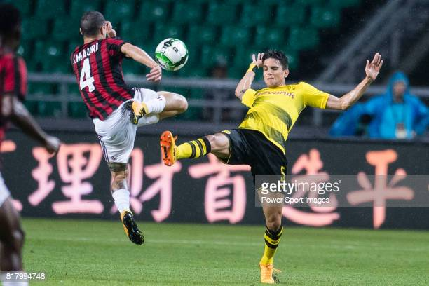 Borussia Dortmund Defender Marc Bartra trips up with AC Milan Midfielder Jose Mauri during the International Champions Cup 2017 match between AC...