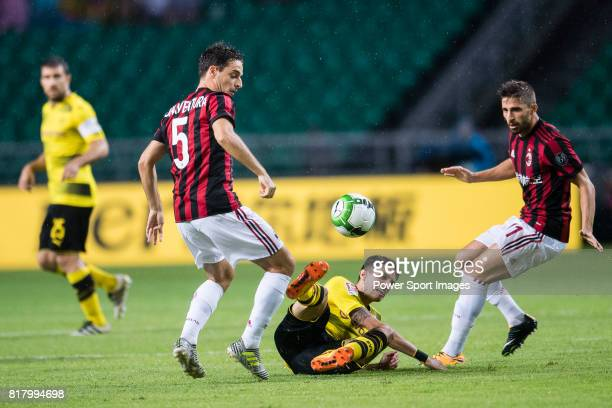 Borussia Dortmund Defender Marc Bartra trips up with AC Milan Midfielder Giacomo Bonaventura during the International Champions Cup 2017 match...