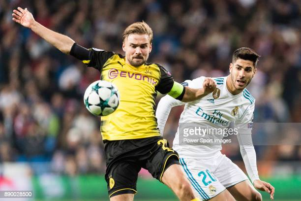 Borussia Dortmund Defender Marcel Schmelzer in action against Marco Asensio of Real Madrid during the Europe Champions League 201718 match between...