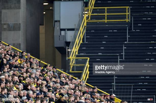 Borussia Dortmund fans are seen in front of the closed south stand during the Bundesliga soccer match between Borussia Dortmund and VfL Wolfsburg at...