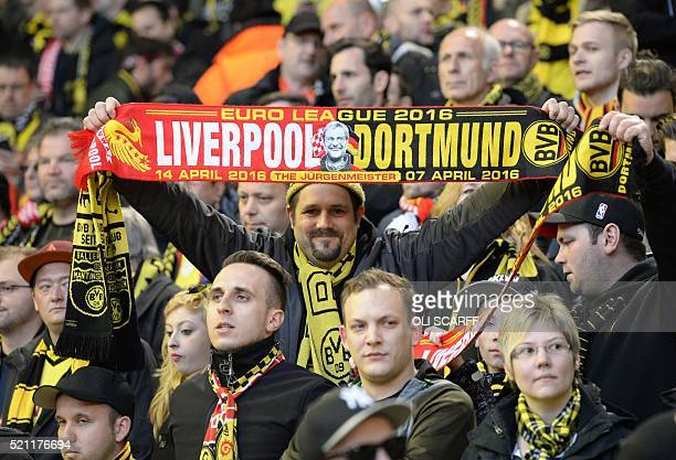 Borussia Dortmund fans cheer during the UEFA Europa league quarterfinal second leg football match between Liverpool and Borussia Dortmund at Anfield...