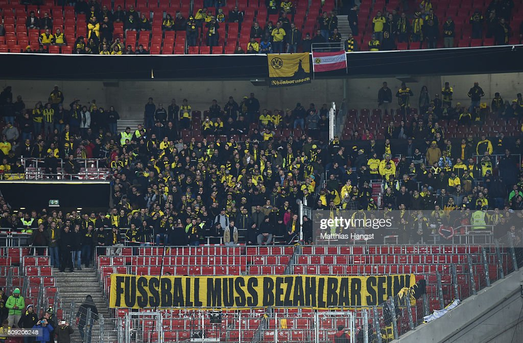 Borussia Dortmund fans protest against seat ticket prices prior to the DFB Cup Quarter Final match between VfB Stuttgart and Borussia Dortmund at Mercedes-Benz Arena on February 9, 2016 in Stuttgart, Germany.