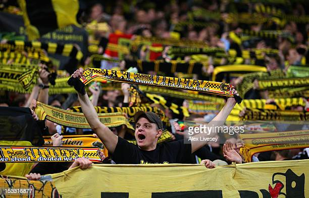 Borussia Dortmund fans show their support during the UEFA Champions League Group D match between Manchester City and Borussia Dortmund at the Etihad...