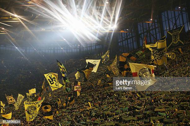 Borussia Dortmund fans show their support prior to the Bundesliga match between Borussia Dortmund and FC Bayern Muenchen at Signal Iduna Park on...