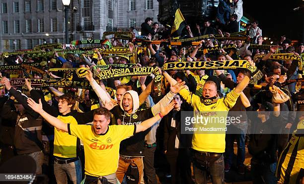 Borussia Dortmund fans taunt Bayern Munich supporters in Piccadilly after the defeat of their team in the UEFA Champions League final on May 25 2013...