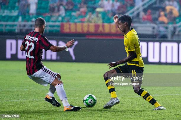 Borussia Dortmund Forward Alexander Isak fights for the ball with AC Milan Midfielder Mateo Musacchio during the International Champions Cup 2017...